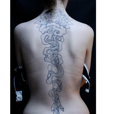 vertical cursive artistic spine tattoo