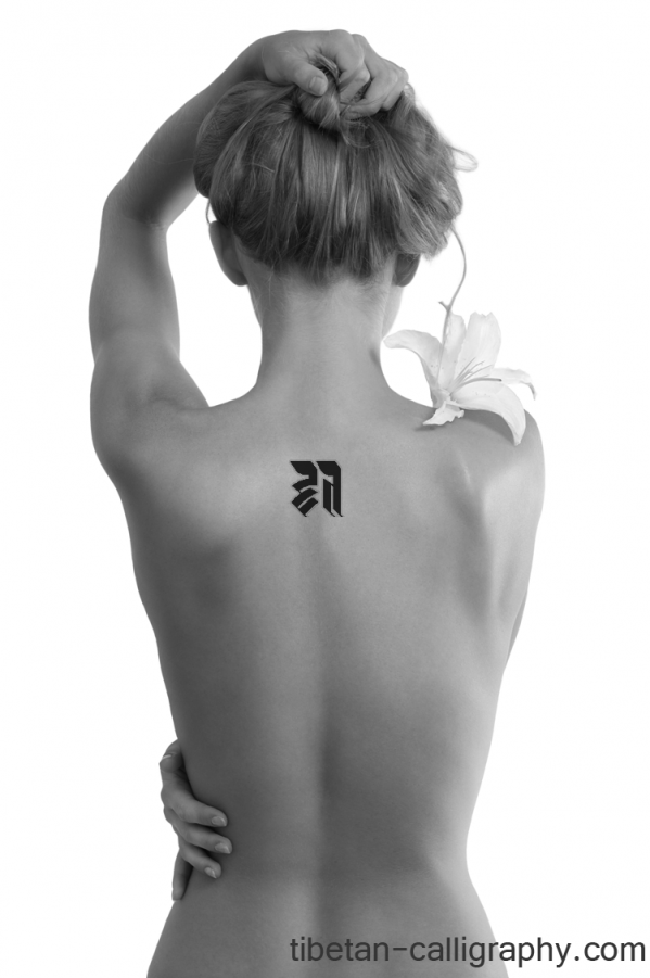 Initial tattoo in the back of a woman